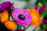 Bright bouquet of Ranunculus and decorative poppies
