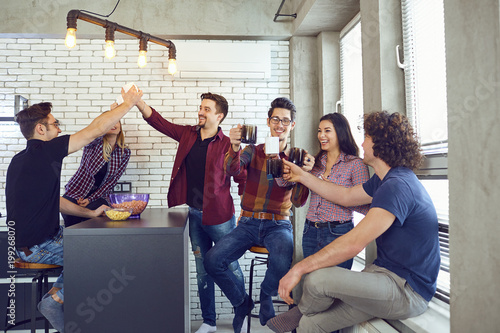 A group of friends at the meeting communicate fun inside the room.