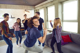 Friends dance fun at a student's party in the apartment. - 199268423