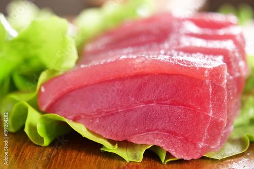 Macro shot of sushi, sashimi, uramaki and nighiri. typical Japanese dish consisting of rice, salmon or tuna,shrimp and fish eggs soaked in soy. Concept: Japanese restaurant, sushi,  - 199284282