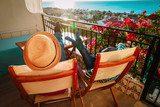 Dad and son relax on balcony terrace - 199285023