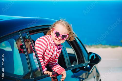 happy little girl enjoy travel by car at sea