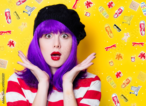 Portrait of a young woman with purple hair on yellow background with ojects