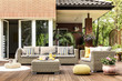 Yellow pouf on wooden patio