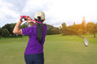 Asian woman player golf swing shot