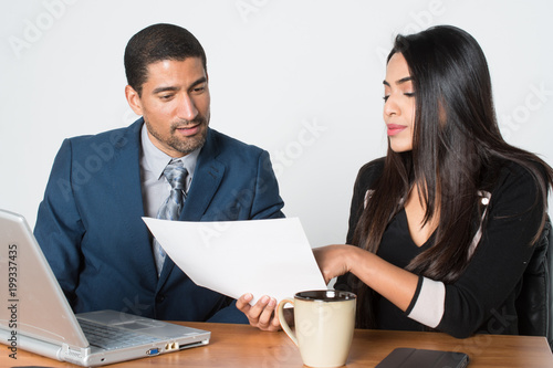 Businesswoman At Work With A Client