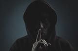 Thief making silence gesture. - 199342464