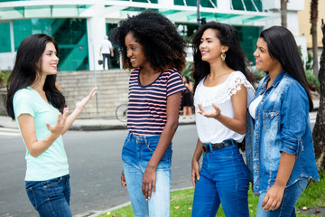 Group of international young adult woman in discussion