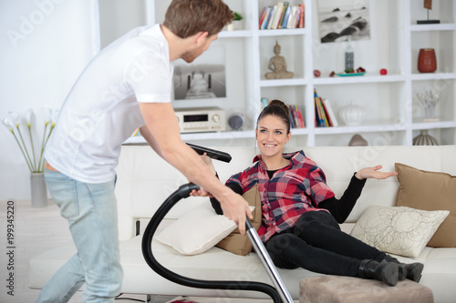 positive family couple doing regular clean-up at home Poster