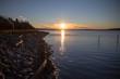 Looking along White Rock beach to dramatic winter sunrise.