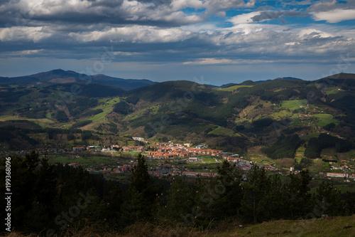Foto op Plexiglas Zwart Typical Basque landscape seen from the mountain, Zalla, Spain