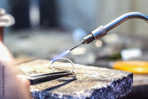 Jeweler using a gas - oxygen welding torch. © Ruben