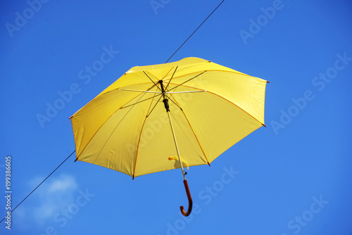 umbrella flying on a blue sky