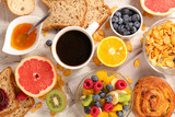 coffee cup , fruit and cereals