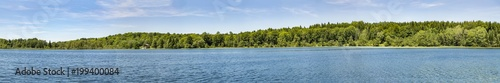 Poster Panoramafoto s trees grow in the lake of Ilay