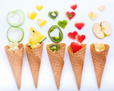 Various fruits in waffle cones  and heart shape of fruits setup on white wooden background . Valentine 's day and Sweet menu concept. - 199405243