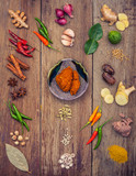 Various of Thai food Cooking ingredients and spice red curry paste ingredient of thai popular food on rustic wooden background. Spices ingredients chilli ,pepper, garlic and Kaffir lime leaves . - 199406646