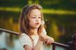 little girl with dandelion in park