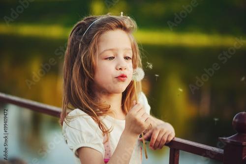 little girl with dandelion in park - 199409472