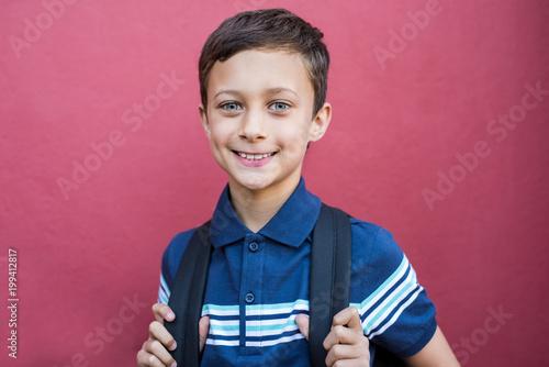 Smiling boy with school bag