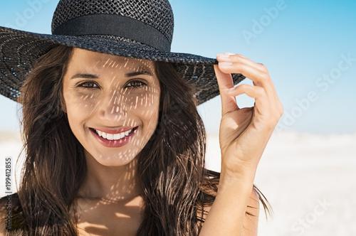 Woman wearing black hat at beach