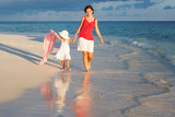 Mother and little daughter walking on the beach - 199430230