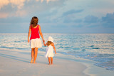 Mother and little daughter walking on the beach - 199430242