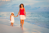Mother and little daughter walking on the beach - 199430256