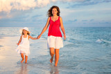 Mother and little daughter walking on the beach - 199430273
