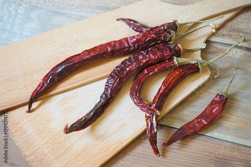 Plexiglas Hot chili peppers Dried red hot cili peppers.