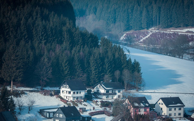 Houses in snowy mountain valley. Niedersfeld, Germany.