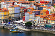 Porto, Portugal old town aerial promenade view with colorful houses, Douro river and boats