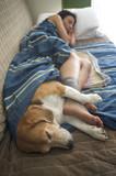 Girl sleeping with her dog - 199454233