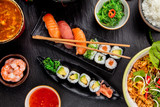 Asian Sushi variation with many kinds of meals. - 199458650