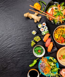 Asian food variation with many kinds of meals and sushi - 199458680