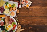 Set breakfast. Eggs, yogurt, fruits, cheese. Top view. On a wooden background. Copy space. - 199461804