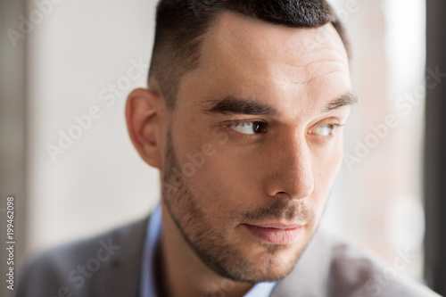 business, corporate and people concept - portrait of businessman in suit at office - 199462098