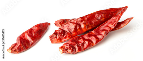 Foto op Aluminium Verse groenten dried red chillies isolated on white