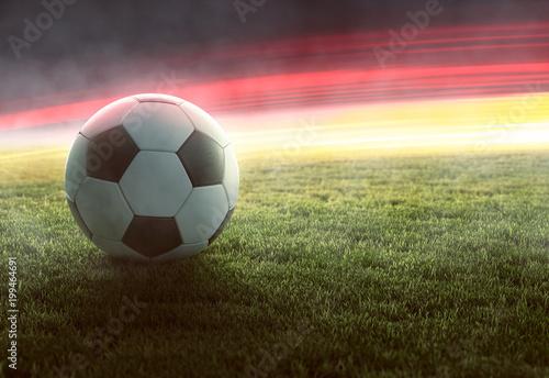 Fotobehang Gras Fußball vor deutschlandfarbenden Lichteffekten