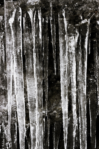 Large and long icicles and frosted water on rocks in Central Balkan National Park, Bulgaria - 199468230