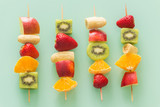 fruit skewers the concept of healthy eating / pastel green glass background. - 199479822