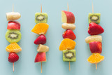 fruit skewers the concept of healthy eating / pastel turquoise glass background. - 199479862