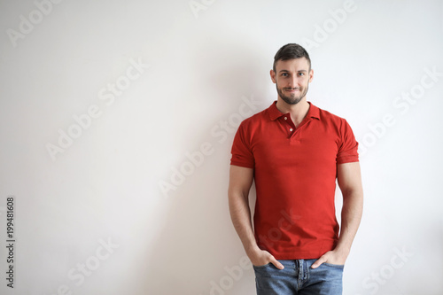 Young man in red polo shirt
