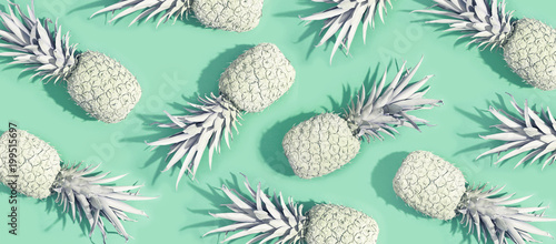 Painted pineapples on a pastel green background - 199515697