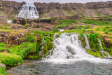 Small stream flowing from waterfall in Iceland