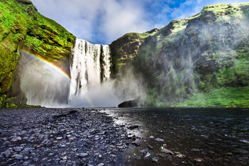 Stunning waterfall Skogafoss and small rainbow, Iceland