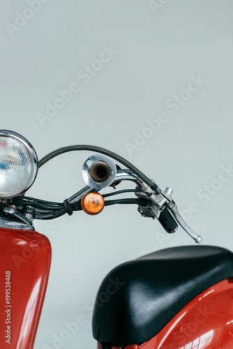 Fotobehang Scooter Red retro scooter bike isolated on grey
