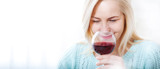 Closeup portrait of female customer drinking red wine with eyes closed. - 199543213