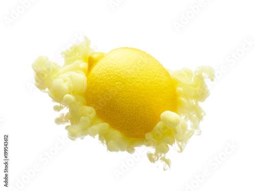 Lemon on ink isolated over white background - 199543612