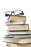 stack of books and glasses on a white background